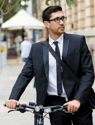 young professional with bycicle